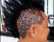 Cheeta skull tattoo